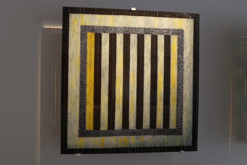 Les sept cent soixante dix sept bougies, Pellicule 35 mm du film de Jean Cocteau « La Belle et la Bête », Technique mixte sous verre, 100 x 100 cm,  2011